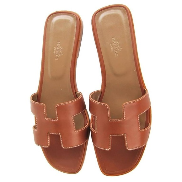2dc085539ee0 Hermes Shoes - Hermes Gold Oran Sandals size 8